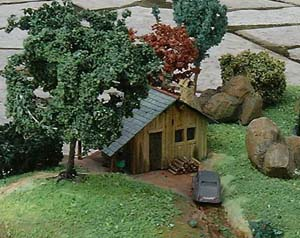 Ajout du décor Une petite cabane en allumettes.